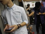 In Asia's trend-setting cities, iPhone fatigue sets in