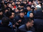 Fans Hurl Eggs At Apple Store In China!